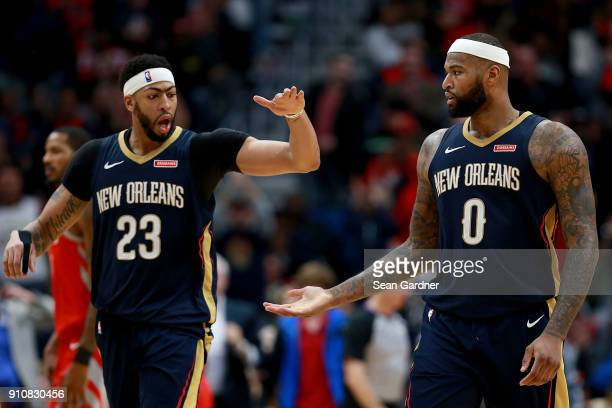 Anthony Davis of the New Orleans Pelicans and DeMarcus Cousins of the New Orleans Pelicans react after scoring against the Houston Rockets during the...