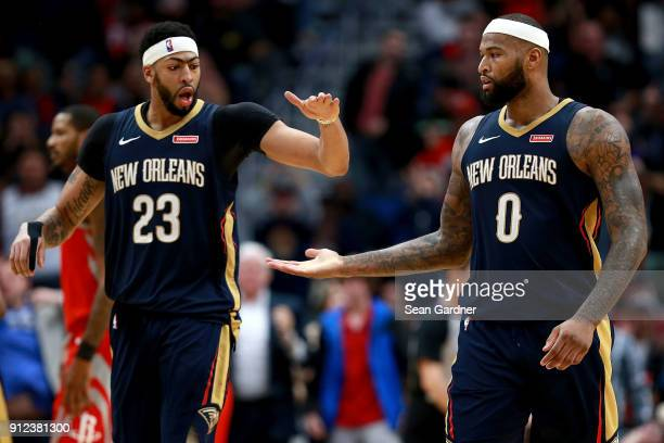Anthony Davis of the New Orleans Pelicans and DeMarcus Cousins of the New Orleans Pelicans react after scoring against the Houston Rockets during a...