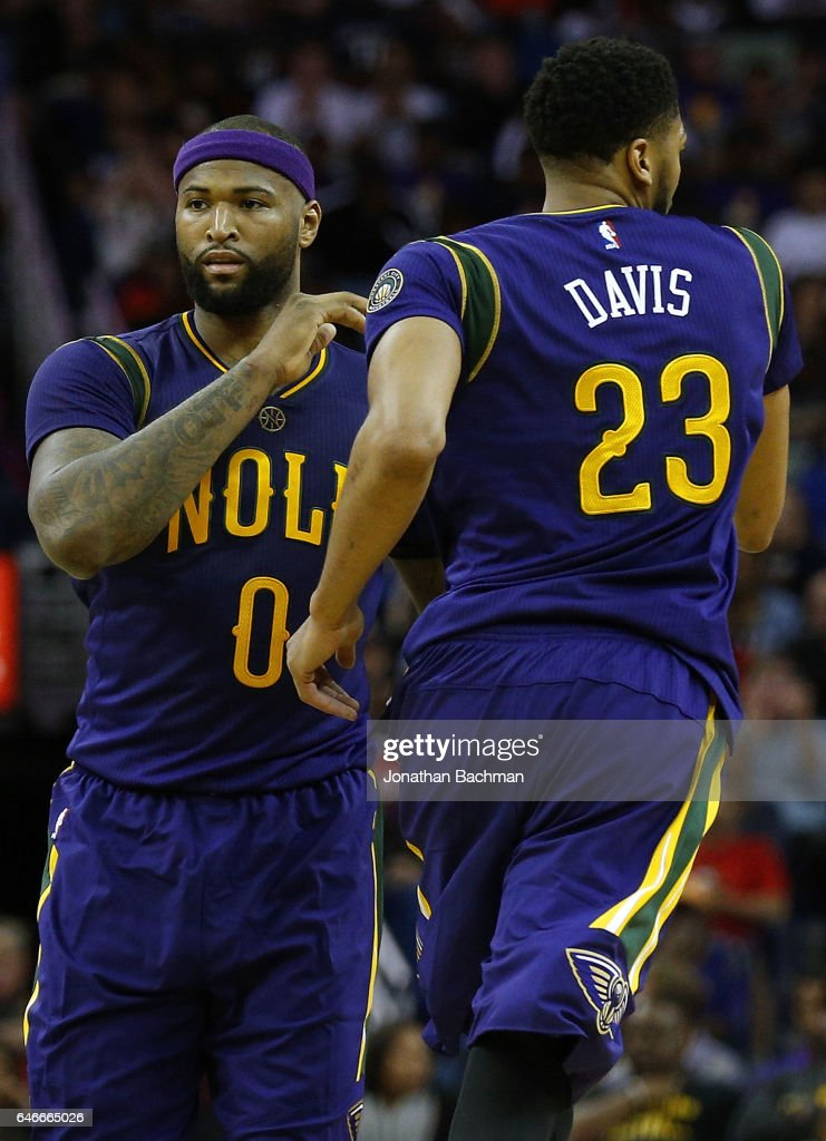 Anthony Davis of the New Orleans Pelicans and DeMarcus Cousins react ... e51acfbab