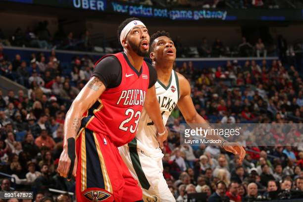 Anthony Davis of the New Orleans Pelicans and Giannis Antetokounmpo of the Milwaukee Bucks look on during the game on December 13 2017 at Smoothie...