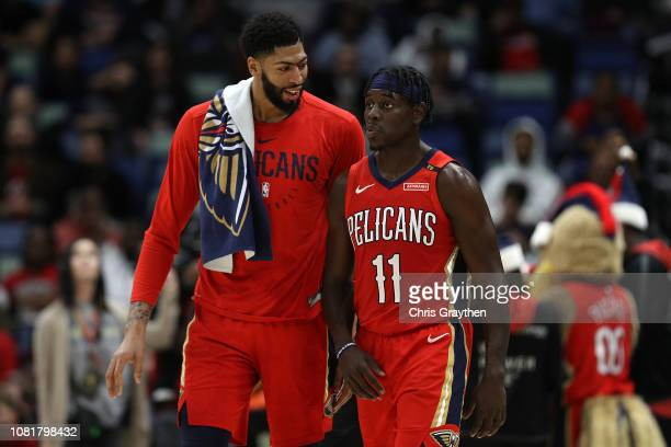 Anthony Davis of the New Orleans Pelicans and Jrue Holiday of the New Orleans Pelicans talk at a timeout against the Oklahoma City Thunder at...
