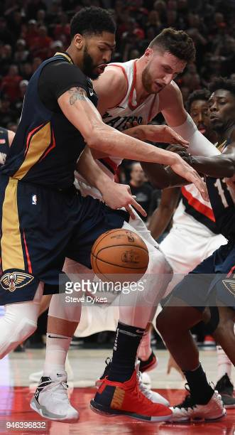 Anthony Davis of the New Orleans Pelicans and Jusuf Nurkic of the Portland Trail Blazers battle for a loose ball during the second half of game one...