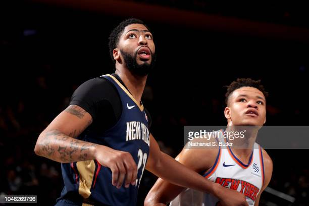 Anthony Davis of the New Orleans Pelicans and Kevin Knox of the New York Knicks are seen on defense during a preseason game on October 5 2018 at...
