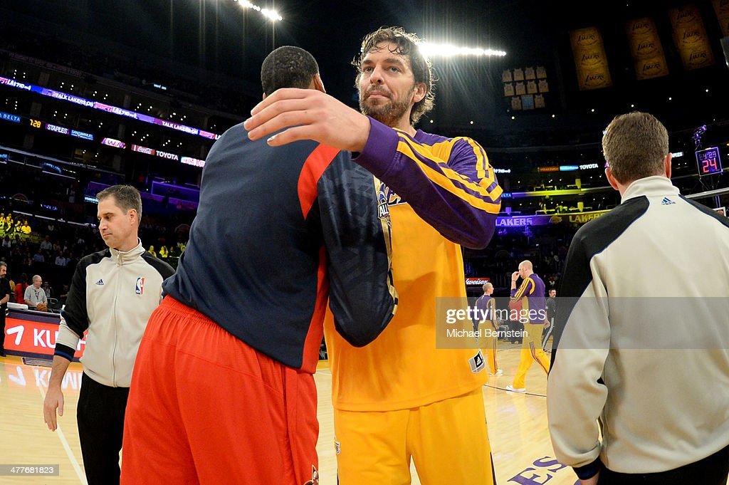 Anthony Davis #23 of the New Orleans Pelicans and Pau Gasol #16 of the Los Angeles Lakers hug before a game at Staples Center on November 12, 2013 in Los Angeles, California.