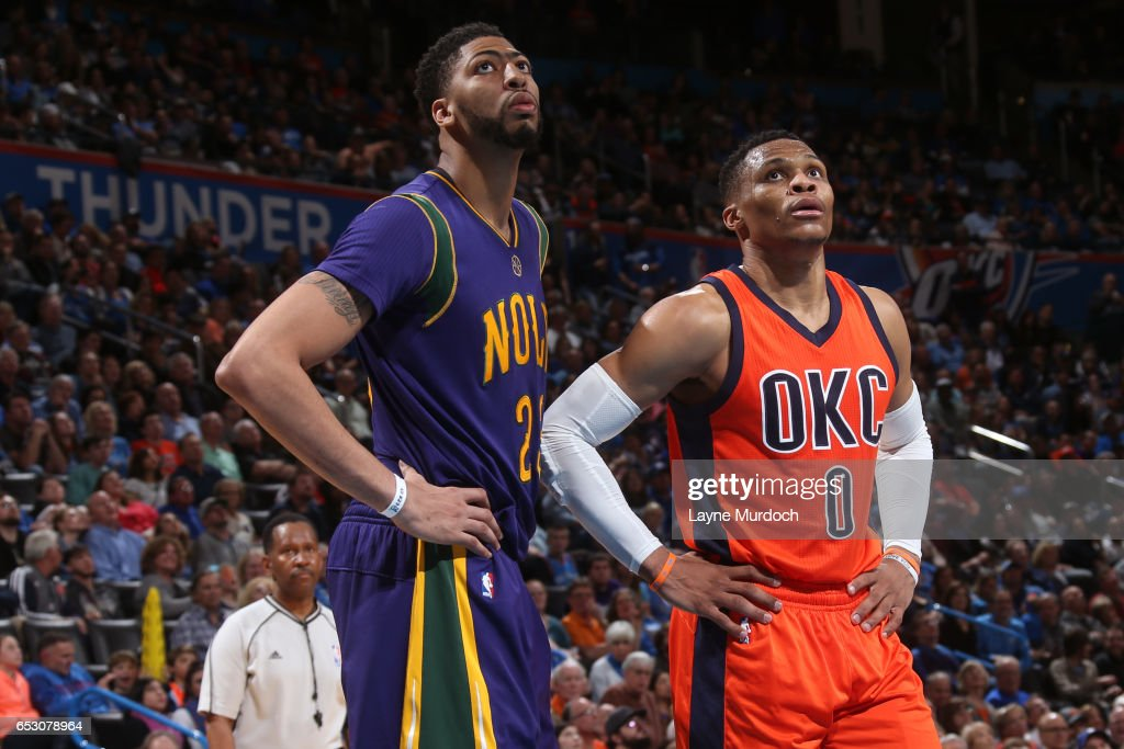 Anthony Davis #23 of the New Orleans Pelicans and Russell Westbrook #0 of the Oklahoma City Thunder looks on during the game on February 26, 2017 at the Chesapeake Energy Arena in Oklahoma City, Oklahoma.