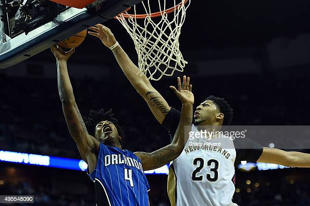 Anthony Davis of the New Orleans Pelicans blocks a shot by Elfrid Payton of the Orlando Magic during the second half of a game at the Smoothie King...