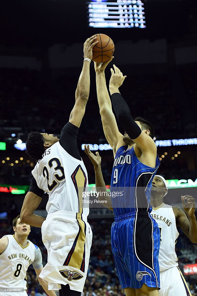 Anthony Davis #23 of the New Orleans Pelicans blocks a shot by Nikola Vucevic #9 of the Orlando Magic during the second half of a game at the Smoothie King Center on November 3, 2015 in New Orleans, Louisiana.
