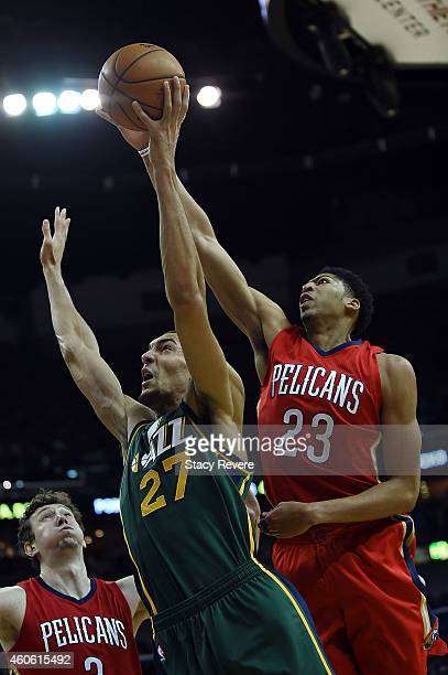 Anthony Davis of the New Orleans Pelicans blocks a shot by Rudy Gobert of the Utah Jazz during the first half of a game at the Smoothie King Center...