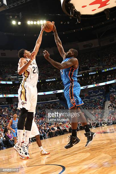 Anthony Davis of the New Orleans Pelicans blocks the shot of Kendrick Perkins of the Oklahoma City Thunder during the game on December 2 2014 at the...