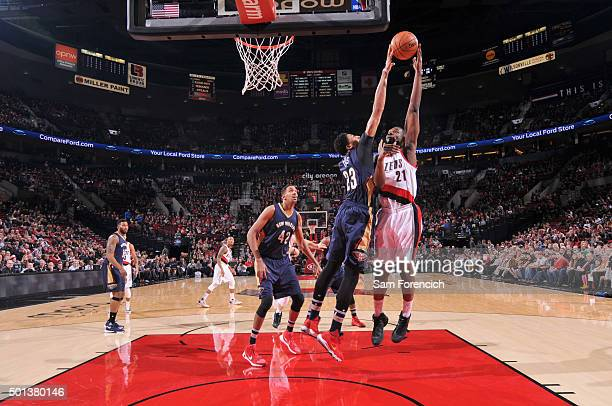 Anthony Davis of the New Orleans Pelicans blocks the shot of Noah Vonleh of the Portland Trail Blazers on December 14 2015 at the Moda Center in...