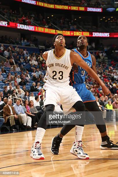 Anthony Davis of the New Orleans Pelicans boxes out Serge Ibaka of the Oklahoma City Thunder during the game on December 2 2014 at the Smoothie King...
