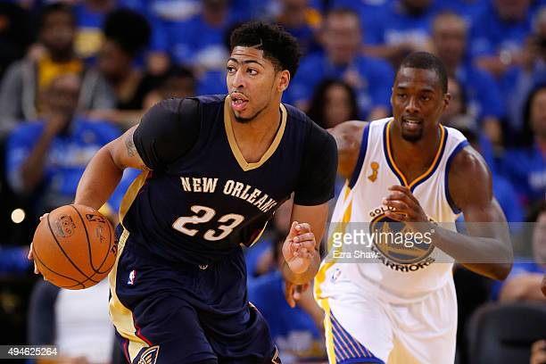 Anthony Davis of the New Orleans Pelicans brings the ball up court against the Golden State Warriors during the NBA season opener at ORACLE Arena on...