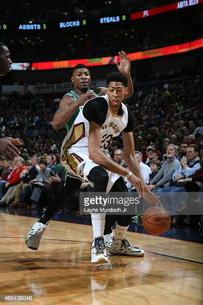 Anthony Davis of the New Orleans Pelicans defends the ball against the Boston Celtics during the game on March 6 2015 at Smoothie King Center in New...