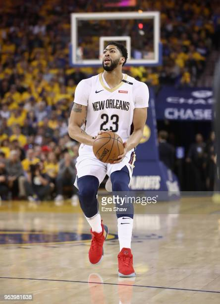 Anthony Davis of the New Orleans Pelicans dribbles in action against the Golden State Warriors during Game Two of the Western Conference Semifinals...