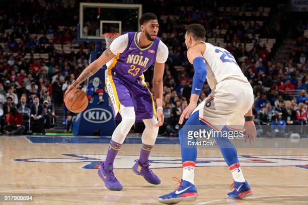 Anthony Davis of the New Orleans Pelicans dribbles the ball while guarded by Ben Simmons of the Philadelphia 76ers at Wells Fargo Center on February...
