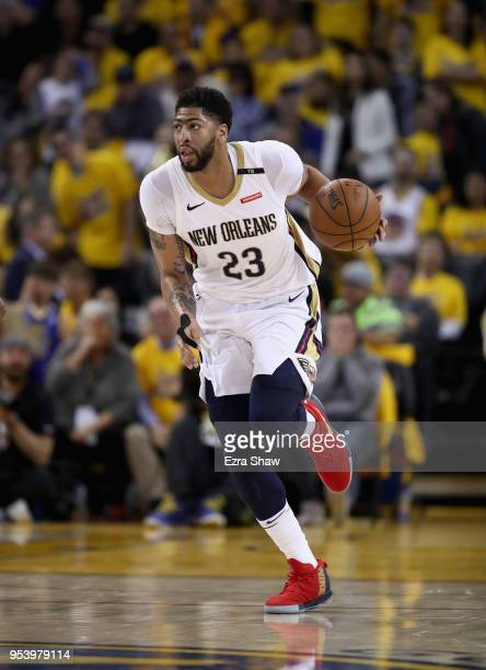 Anthony Davis of the New Orleans Pelicans dribbles up court against the Golden State Warriors during Game Two of the Western Conference Semifinals...