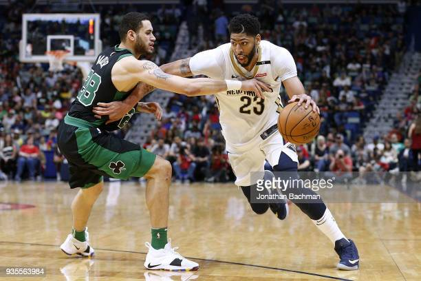 Anthony Davis of the New Orleans Pelicans drives against Abdel Nader of the Boston Celtics during the second half at the Smoothie King Center on...