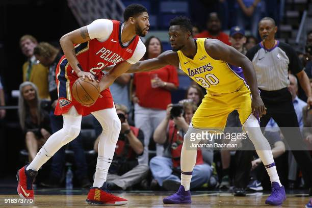 Anthony Davis of the New Orleans Pelicans drives against Julius Randle of the Los Angeles Lakers during the first half at Smoothie King Center on...