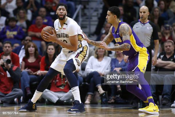 Anthony Davis of the New Orleans Pelicans drives against Kyle Kuzma of the Los Angeles Lakers during the second half at the Smoothie King Center on...