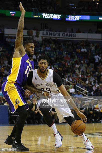 Anthony Davis of the New Orleans Pelicans drives against Thomas Robinson of the Los Angeles Lakers during the first half of a game at the Smoothie...