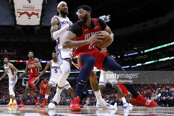 Anthony Davis of the New Orleans Pelicans drives against Willie CauleyStein of the Sacramento Kings during the first half at the Smoothie King Center...