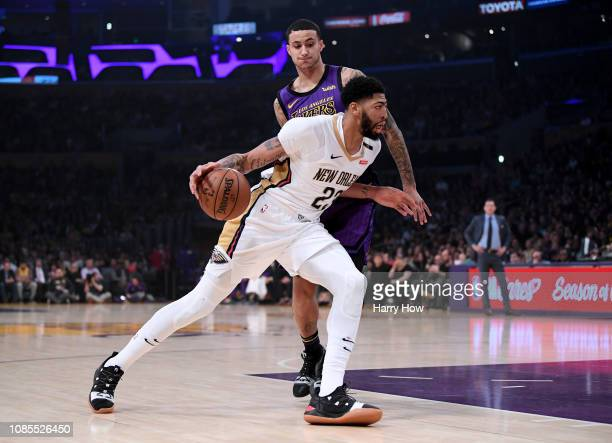 Anthony Davis of the New Orleans Pelicans drives on Kyle Kuzma of the Los Angeles Lakers during the first half at Staples Center on December 21 2018...