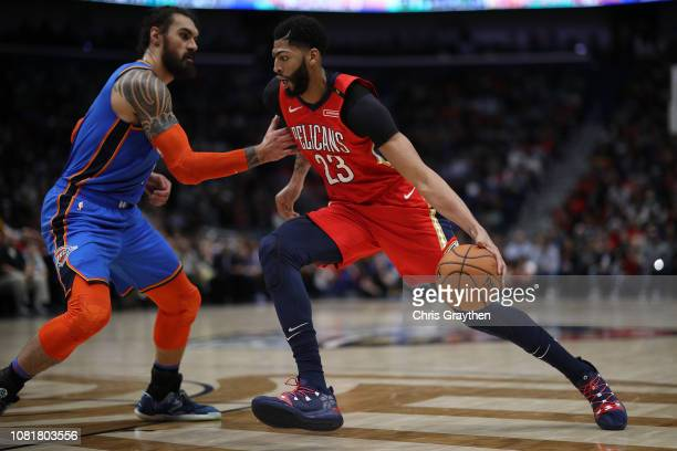 Anthony Davis of the New Orleans Pelicans drives the ball around Steven Adams of the Oklahoma City Thunder at Smoothie King Center on December 12...