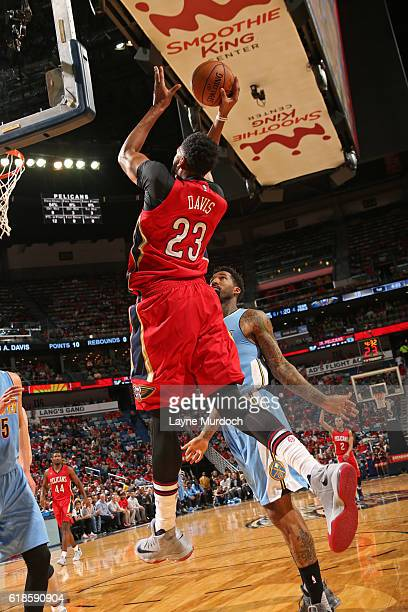 Anthony Davis of the New Orleans Pelicans drives to the basket and shoots the ball against the Denver Nuggets on October 26 2016 at the Smoothie King...