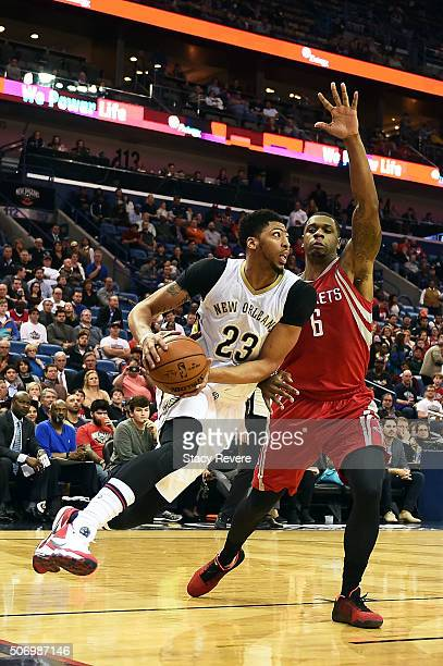 Anthony Davis of the New Orleans Pelicans drives to the basket against Terrence Jones of the Houston Rockets during the first half of a game at the...