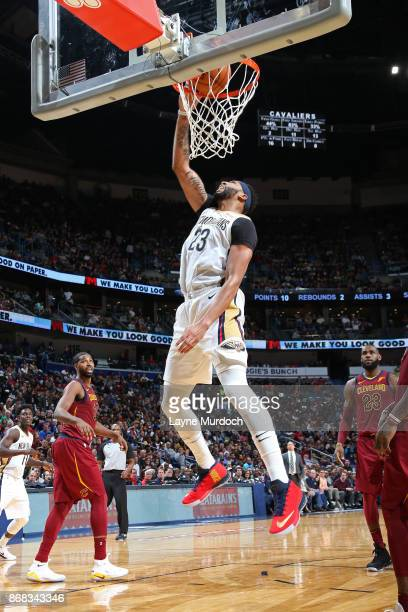 Anthony Davis of the New Orleans Pelicans dunks against the Cleveland Cavaliers on October 28 2017 at the Smoothie King Center in New Orleans...