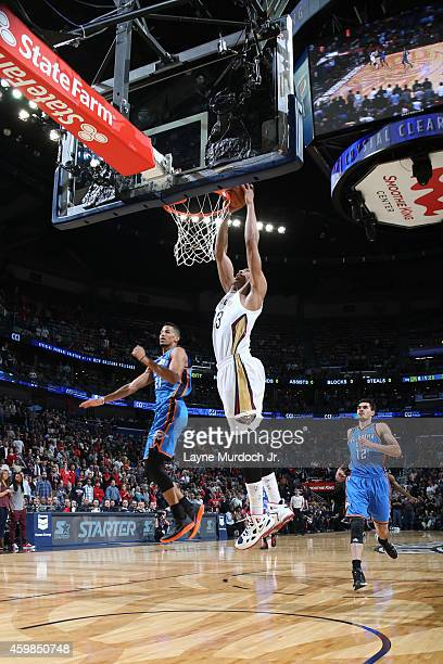 Anthony Davis of the New Orleans Pelicans dunks against the Oklahoma City Thunder during the game on December 2 2014 at the Smoothie King Center in...