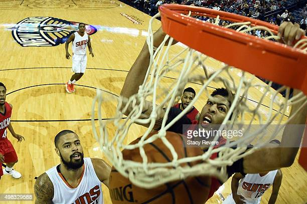 Anthony Davis of the New Orleans Pelicans dunks during the first half of a game against the Phoenix Suns at the Smoothie King Center on November 22...