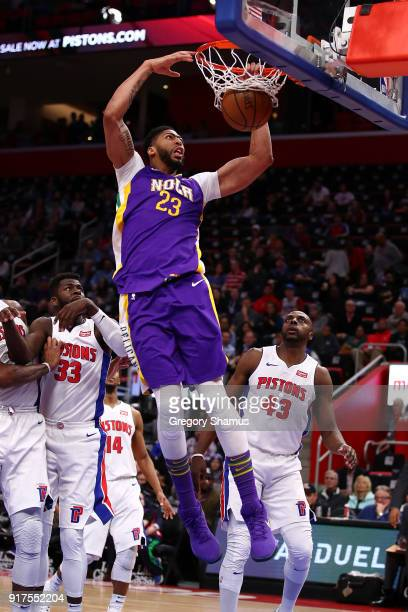 Anthony Davis of the New Orleans Pelicans dunks in front of Anthony Tolliver of the Detroit Pistons during the first half at Little Caesars Arena on...