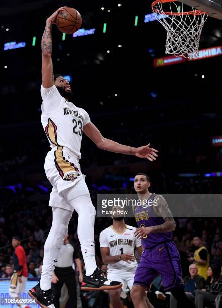 Anthony Davis of the New Orleans Pelicans dunks in front of Kyle Kuzma of the Los Angeles Lakers during the first half at Staples Center on December...