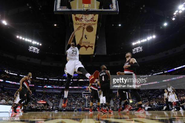 Anthony Davis of the New Orleans Pelicans dunks over Jusuf Nurkic of the Portland Trail Blazers and Maurice Harkless during the second half of a game...
