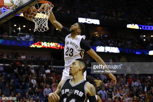 Anthony Davis of the New Orleans Pelicans dunks the ball against Danny Green of the San Antonio Spurs during the second half of a game at the...