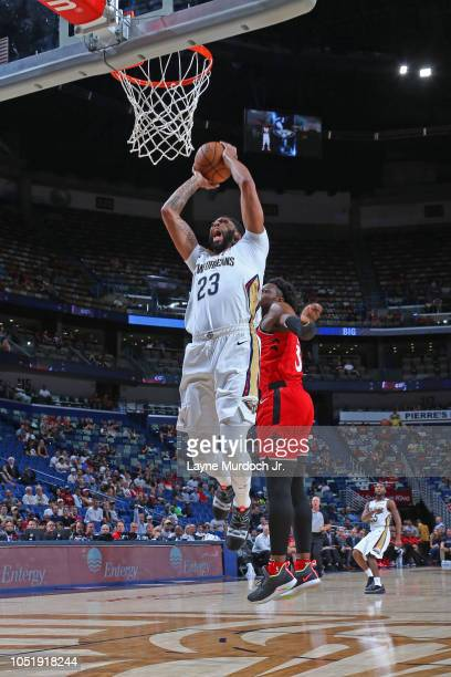 Anthony Davis of the New Orleans Pelicans dunks the ball against the Toronto Raptors during a preseason game on October 11 2018 at Smoothie King...