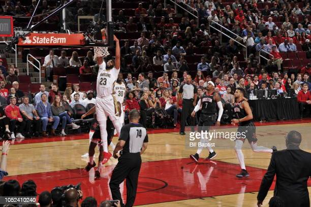Anthony Davis of the New Orleans Pelicans dunks the ball against the Houston Rockets during a game on October 17 2018 at Toyota Center in Houston...