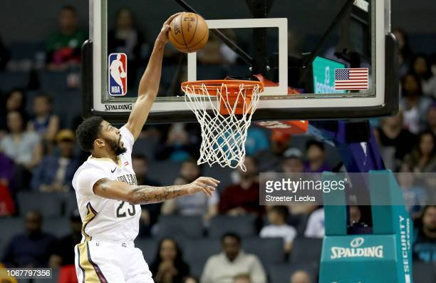 Anthony Davis of the New Orleans Pelicans dunks the ball against the Charlotte Hornets during their game at Spectrum Center on December 2 2018 in...