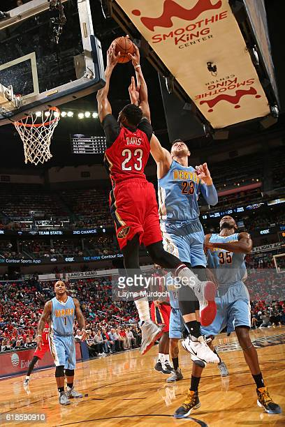 Anthony Davis of the New Orleans Pelicans dunks the ball against the Denver Nuggets on October 26 2016 at the Smoothie King Center in New Orleans...