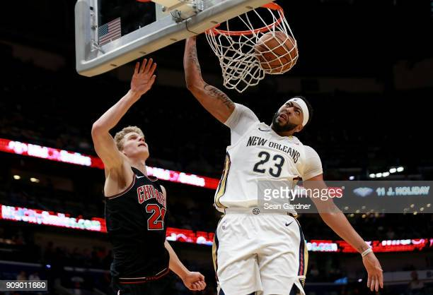 Anthony Davis of the New Orleans Pelicans dunks the ball on Lauri Markkanen of the Chicago Bulls during the second half of a NBA game at Smoothie...