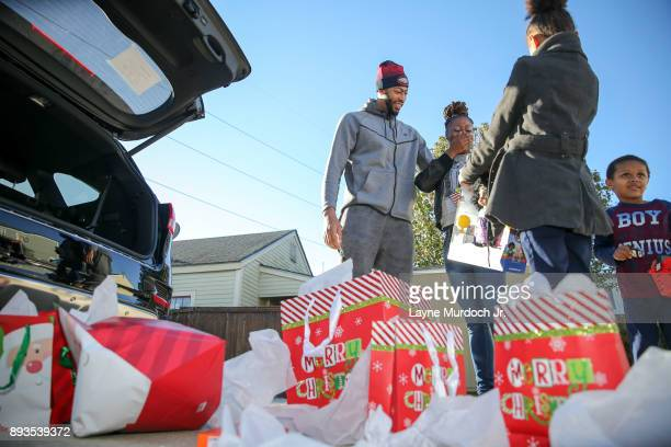 Anthony Davis of the New Orleans Pelicans gives a car and Christmas gifts to an unsuspecting family on December 14 2017 at the Kingsley House...
