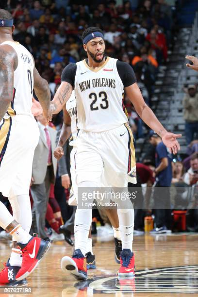 Anthony Davis of the New Orleans Pelicans gives teammates a high five during the game against the Cleveland Cavaliers on October 28 2017 at the...