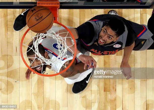 Anthony Davis of the New Orleans Pelicans goes for a rebound against Kyrie Irving of the Cleveland Cavaliers during 2017 NBA AllStar Game at Smoothie...