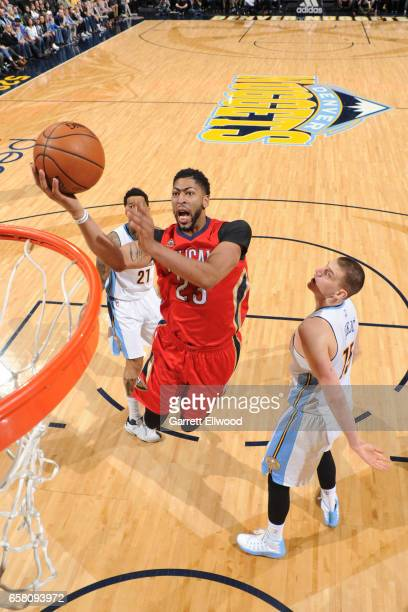 Anthony Davis of the New Orleans Pelicans goes up for a lay up against the Denver Nuggets on March 26 2017 at the Pepsi Center in Denver Colorado...