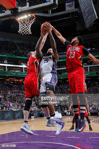 Anthony Davis of the New Orleans Pelicans goes up to block a shot by DeMarcus Cousins of the Sacramento Kings during a game on November 8 2016 at the...