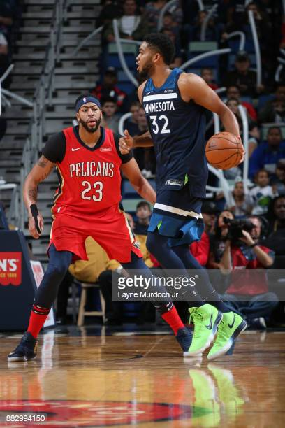 Anthony Davis of the New Orleans Pelicans guards KarlAnthony Towns of the Minnesota Timberwolves on November 29 2017 at Smoothie King Center in New...