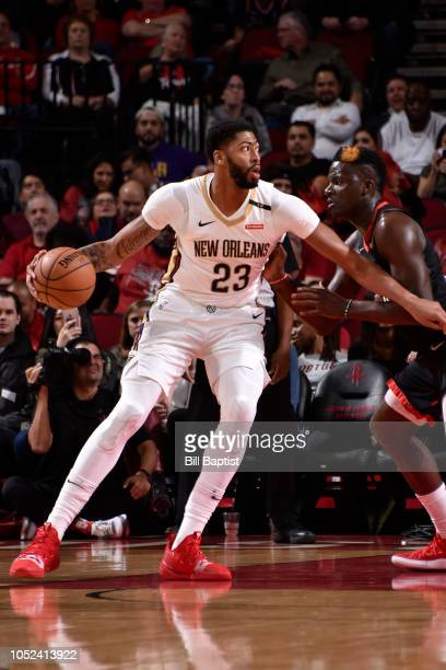 Anthony Davis of the New Orleans Pelicans handles the ball against the Houston Rockets during a game on October 17 2018 at Toyota Center in Houston...