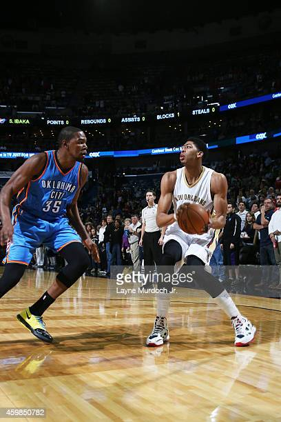 Anthony Davis of the New Orleans Pelicans handles the ball against Kevin Durant of the Oklahoma City Thunder during the game on December 2 2014 at...