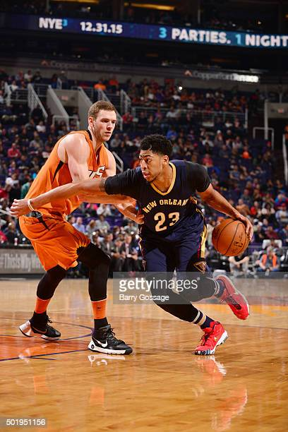 Anthony Davis of the New Orleans Pelicans handles the ball against Jon Leuer of the Phoenix Suns on December 18 2015 at Talking Stick Resort Arena in...
